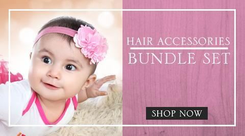 Baby smiling wearing a pink headband in a Hair Accessories Bundle Set Banner - Zuri Baby Couture PH