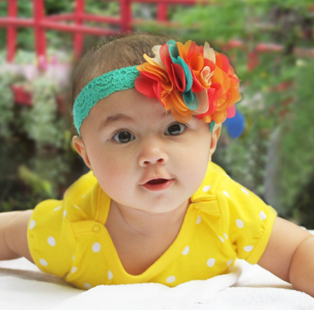 A yellow and white polka-dotted onesie and headband set - Zuri Baby Couture PH